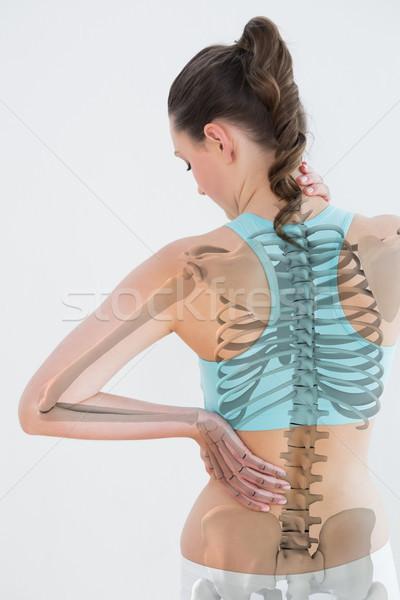 Achteraanzicht vrouwelijke lijden spierpijn witte gezondheid Stockfoto © wavebreak_media