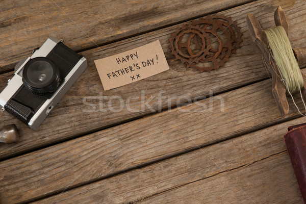 Vintage camera, card, fishing line and gear on wooden plank Stock photo © wavebreak_media