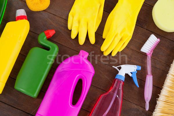 Various cleaning equipment arranged on wooden floor Stock photo © wavebreak_media