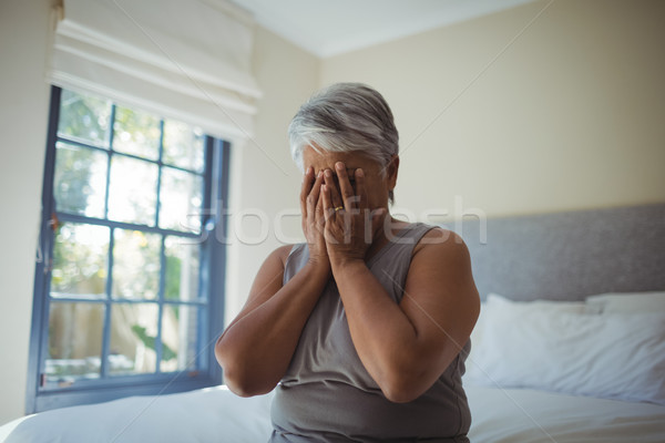 Senior woman covering her face at home Stock photo © wavebreak_media