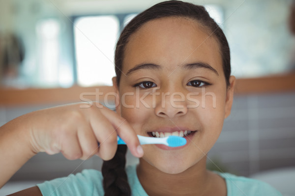 Girl brushing teeth in the bathroom Stock photo © wavebreak_media