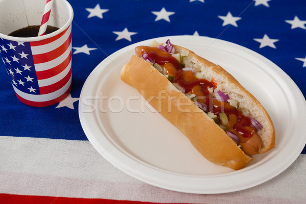 Hot dog served in plate with a drink on American flag Stock photo © wavebreak_media
