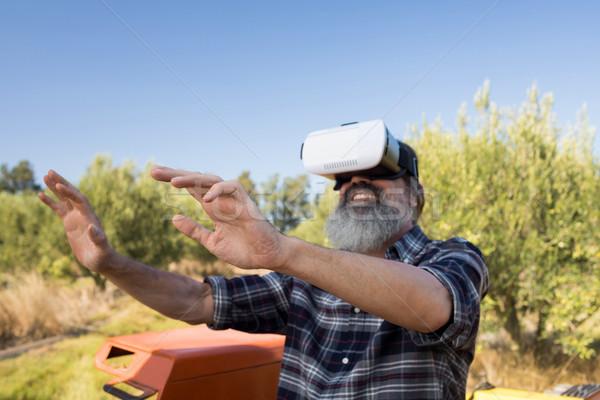 Happy man using virtual reality headset in tractor Stock photo © wavebreak_media