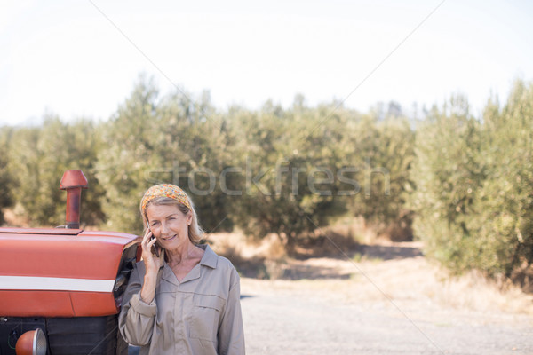 Woman talking on mobile phone in olive farm Stock photo © wavebreak_media