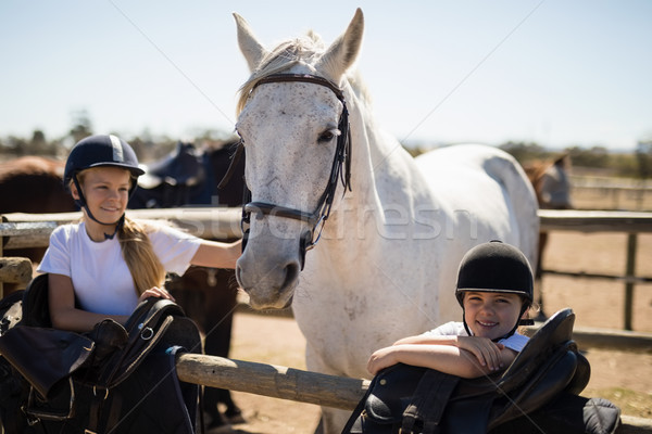 Two girls standing next to the white horse in the ranch Stock photo © wavebreak_media