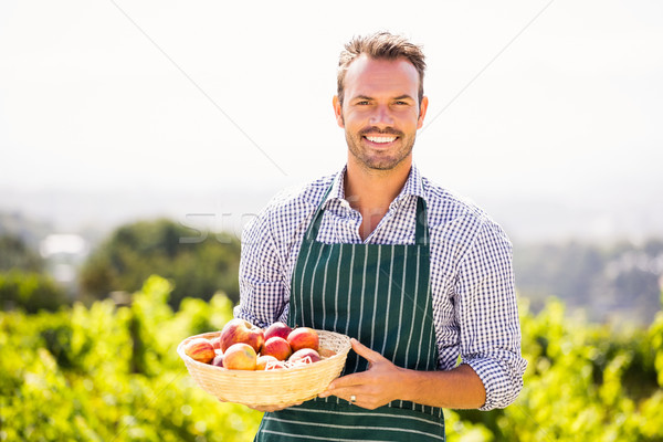 Portré fiatalember tart alma kosár mosolyog Stock fotó © wavebreak_media