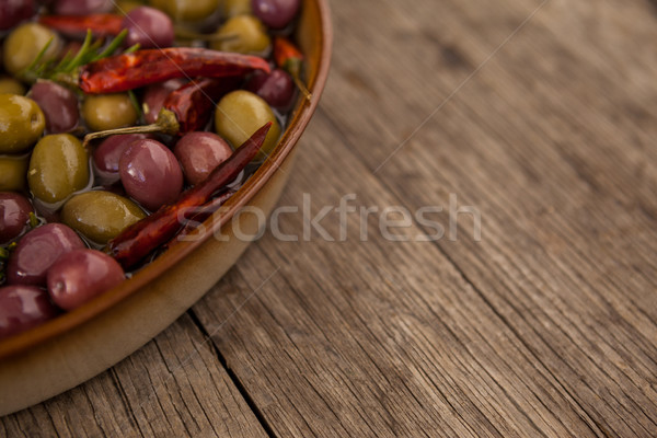 Cropped image of olives with oil and chili pepper in container Stock photo © wavebreak_media