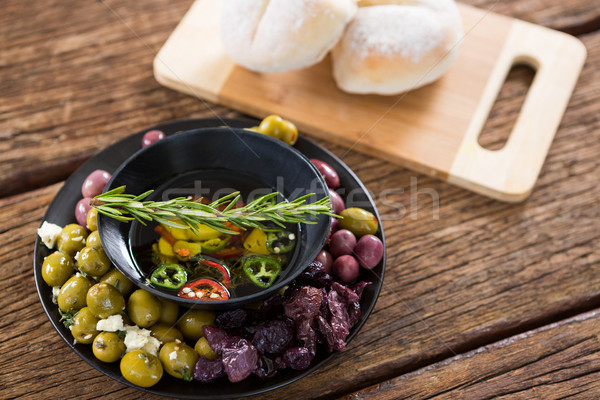 Pickled olives and vegetables with rosemary in bowl Stock photo © wavebreak_media