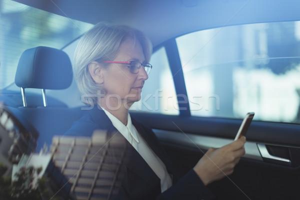 Businesswoman using phone in car Stock photo © wavebreak_media