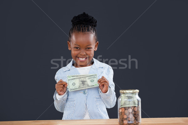 Retrato alegre empresária moedas jarra Foto stock © wavebreak_media
