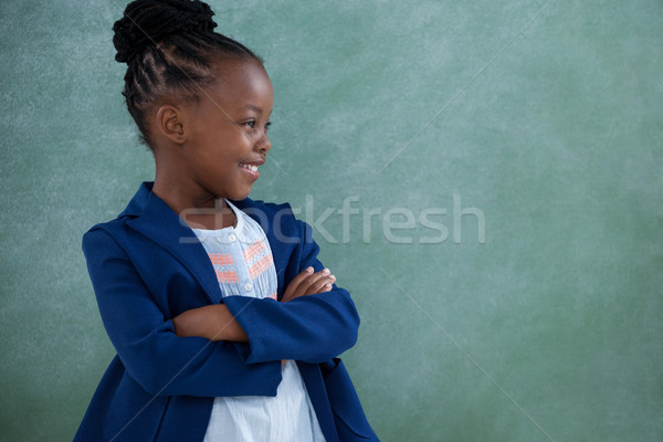 Confident businesswoman with arms crossed against blackboard Stock photo © wavebreak_media