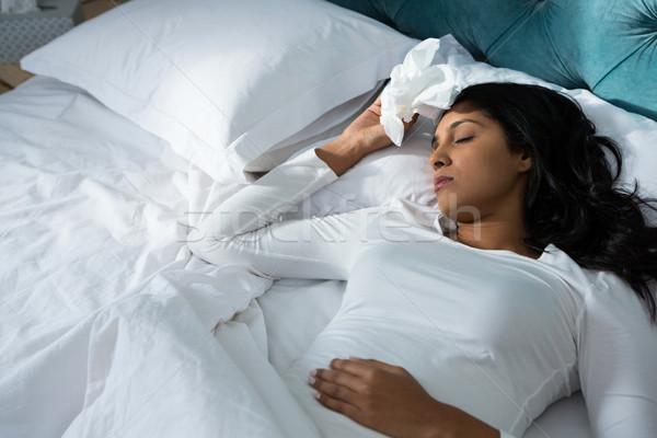 Sick woman sleeping on bed Stock photo © wavebreak_media