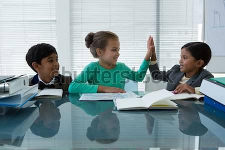 Portrait of smiling kids discussing in boardroom Stock photo © wavebreak_media