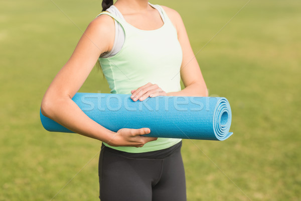 Sporty woman holding exercise mat Stock photo © wavebreak_media