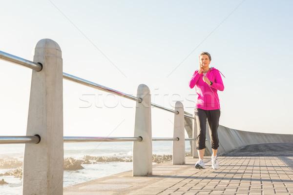笑みを浮かべて スポーティー 女性 ジョギング 遊歩道 ストックフォト © wavebreak_media