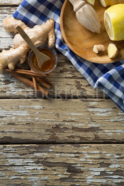 Overhead view of various food with checked napkin on weathered table Stock photo © wavebreak_media