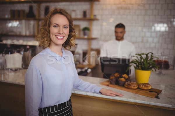 Portrait of confident waitress standing by counter Stock photo © wavebreak_media