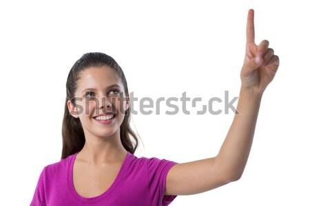 Femenino ejecutivo tocar invisible Screen blanco Foto stock © wavebreak_media