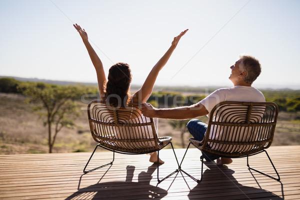 Idős pár ül székek üdülőhely hátsó nézet nő Stock fotó © wavebreak_media