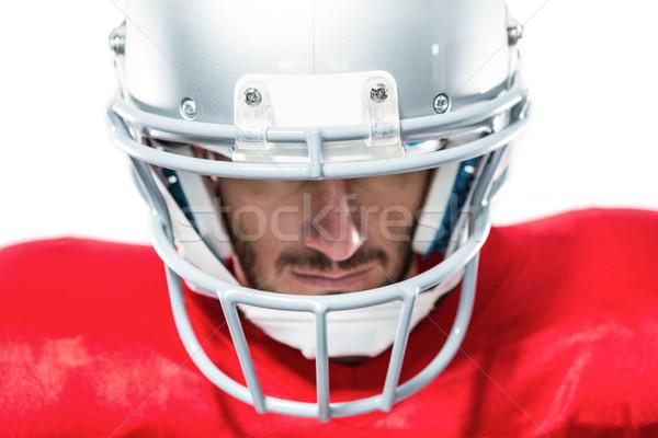 Közelkép amerikai futballista piros lefelé néz fehér Stock fotó © wavebreak_media