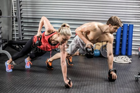Fit couple planking together in gym Stock photo © wavebreak_media