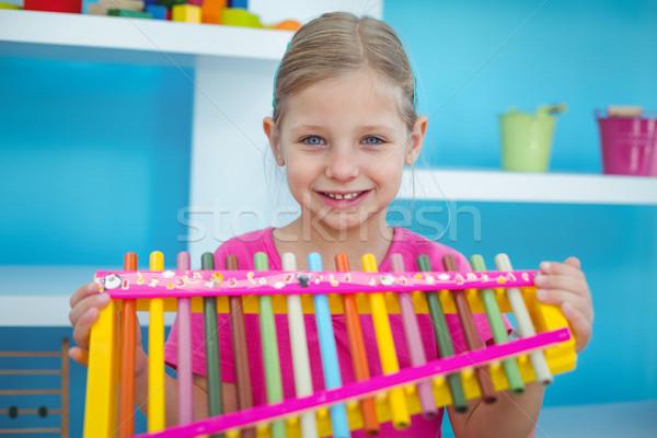笑みを浮かべて 少女 木琴 ルーム 幸せ ストックフォト © wavebreak_media