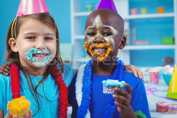 Smiling kids with icing on their faces Stock photo © wavebreak_media