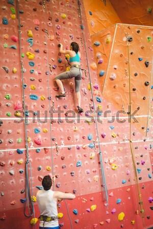 Rear view of athletes climbing wall in health club Stock photo © wavebreak_media