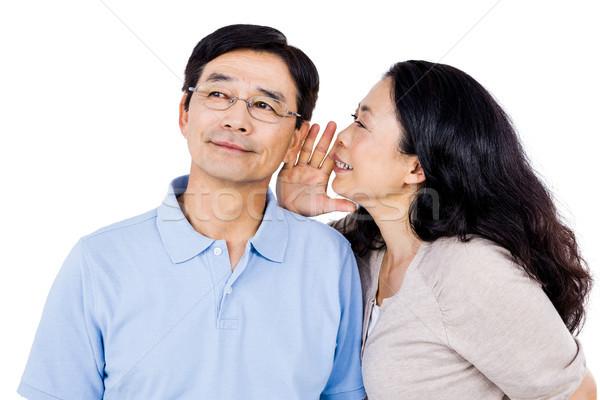 Woman whispering into partners ear Stock photo © wavebreak_media