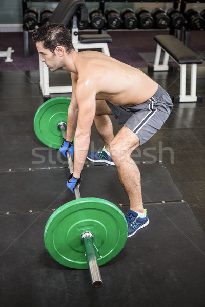 Shirtless man lifting barbell Stock photo © wavebreak_media