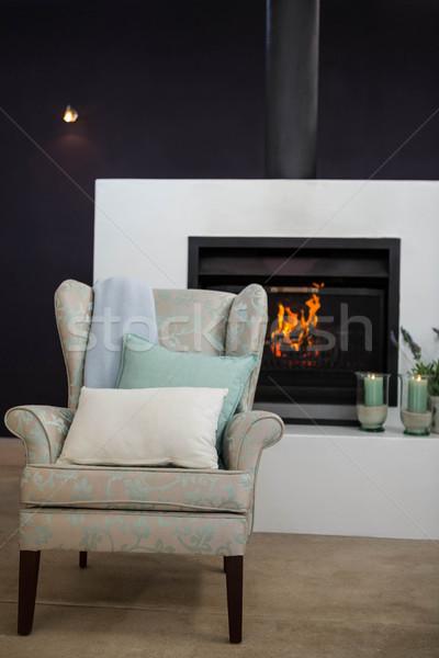 Armchair next to fireplace Stock photo © wavebreak_media