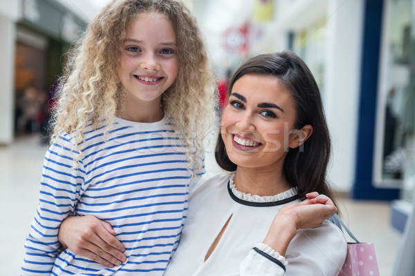 Happy mother and daughter in shopping mall Stock photo © wavebreak_media