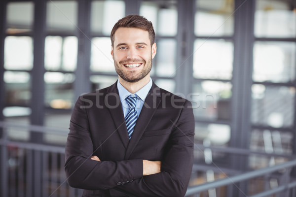Happy businessman with arms crossed Stock photo © wavebreak_media