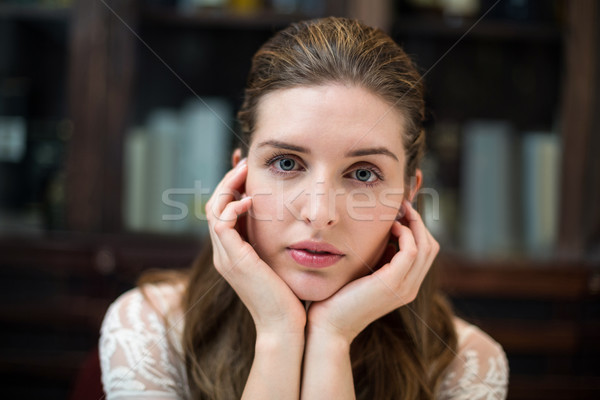 Portrait of sad woman with hand on chin Stock photo © wavebreak_media