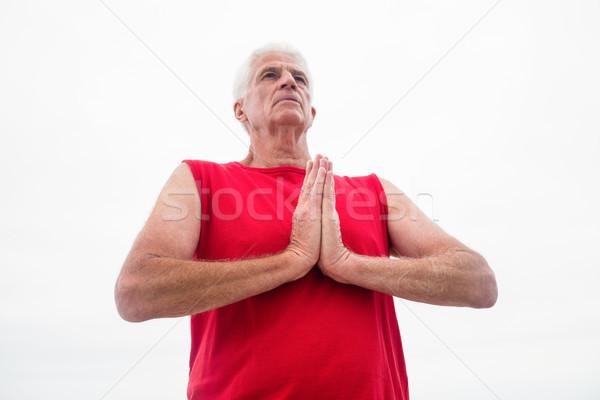 Senior man lotus positie strand fitness Stockfoto © wavebreak_media