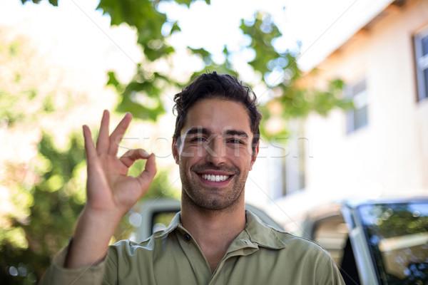 Portrait of smiling pesticide worker showing ok sign  Stock photo © wavebreak_media