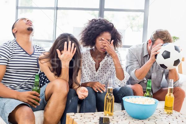 Amigos sessão sofá olhando chateado Foto stock © wavebreak_media