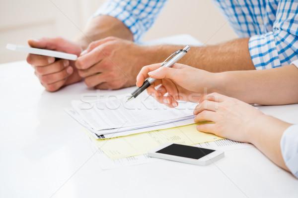 Couple calculating bills Stock photo © wavebreak_media