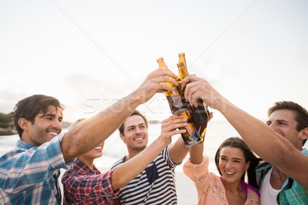 Friends cheering with beer Stock photo © wavebreak_media