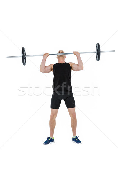 Bodybuilder lifting heavy barbell weights Stock photo © wavebreak_media