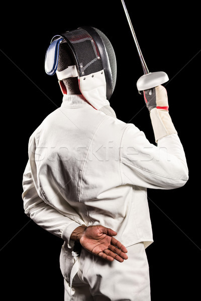 Rear view of man wearing fencing suit practicing with sword Stock photo © wavebreak_media