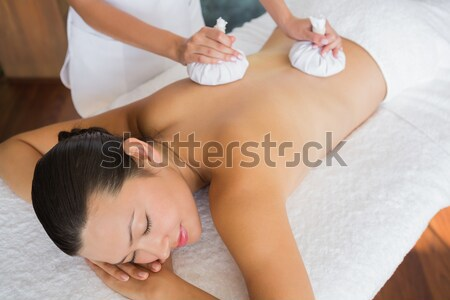 Relaxed naked woman receiving massage Stock photo © wavebreak_media