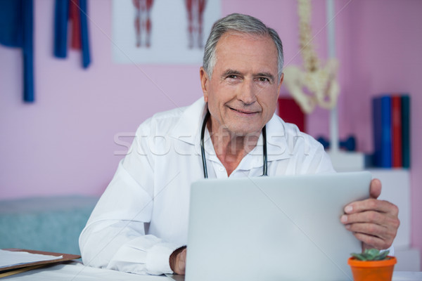 Stock photo: Portrait of physiotherapist using laptop