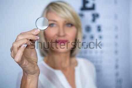 Feminino optometrista lupa clínica Foto stock © wavebreak_media
