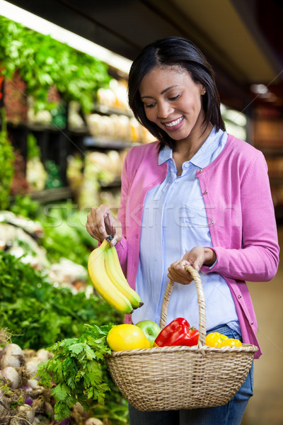 Woman buying banana in organic section Stock photo © wavebreak_media