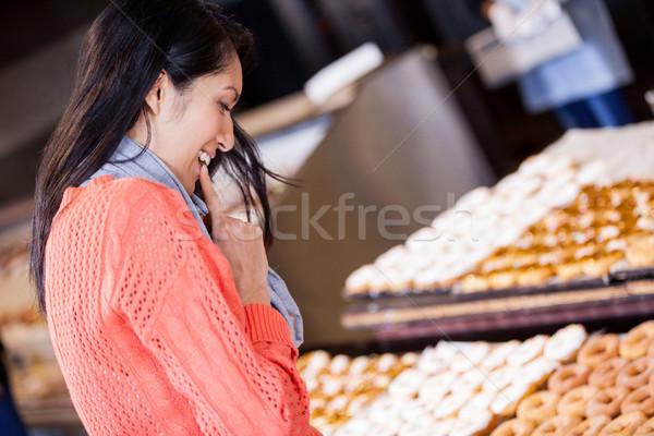 Excited woman selecting doughnuts Stock photo © wavebreak_media