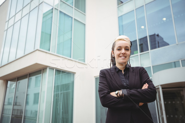 Portrait of smiling businesswoman standing with arms crossed Stock photo © wavebreak_media
