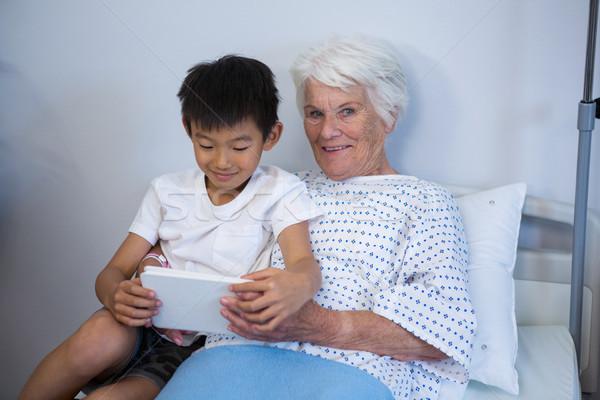 Senior patient and boy holding digital tablet Stock photo © wavebreak_media