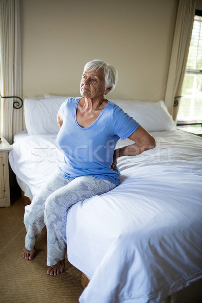 Senior woman suffering from backache in the bedroom Stock photo © wavebreak_media
