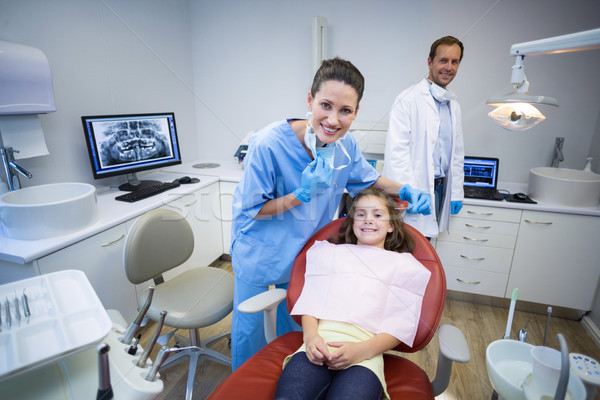 Portrait of smiling dentists and young patient Stock photo © wavebreak_media